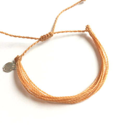Charity Friendship Bracelet Supports Women, Peach