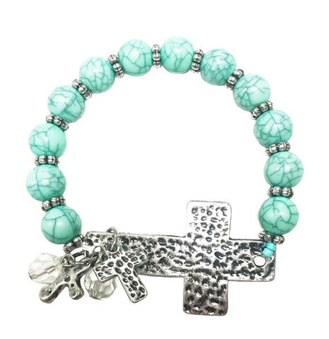 Turquoise side cross bracelet with charm rodeo cowgirl
