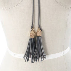 Light grey suede wrap choker with geometric tassel with gold cap