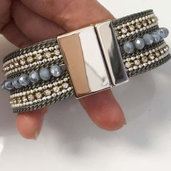 Stacked beaded bracelet with stones and chains dark grey