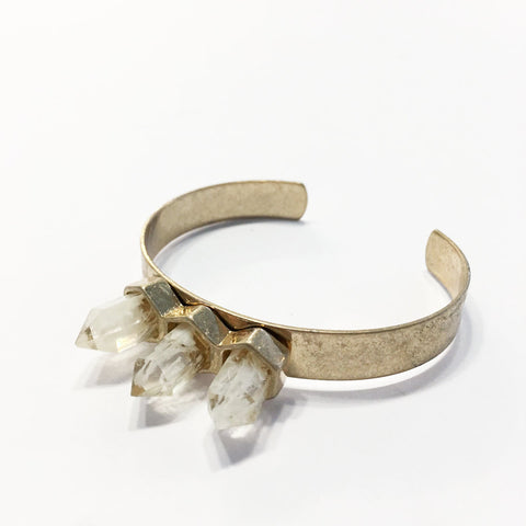 Adjustable oxidized GOLD bangle with WHITE NEUTRAL quartz point