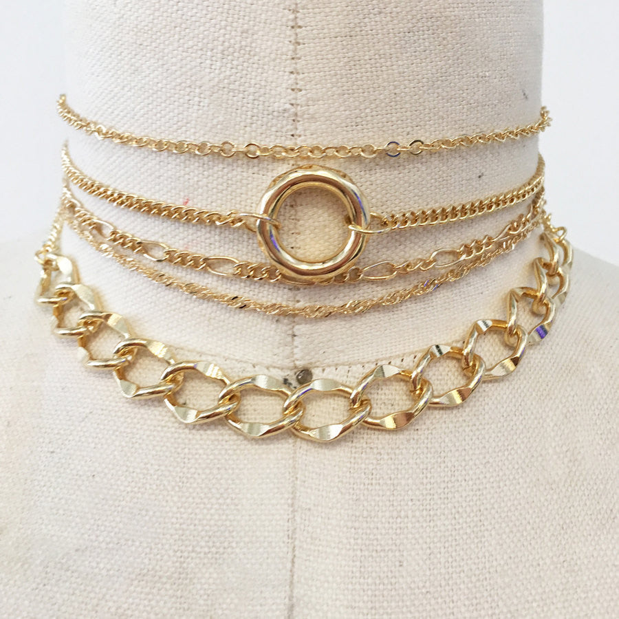 5 layer choker necklace set with gold chains, delicate and modern.