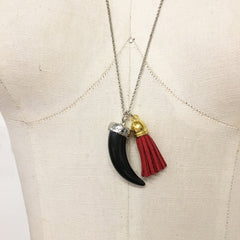 Black horn necklace with red suede tassel