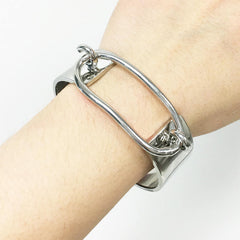 Chunky statement silver bracelet with oval top and hook