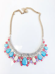 Pastel stone bib with rhinestone and gold chain detail