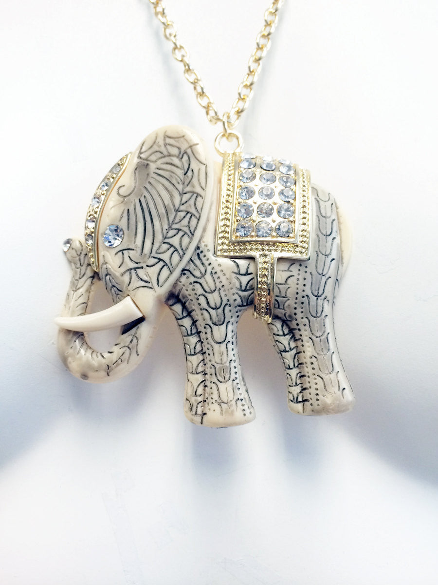 White black and blue etched elephant pendant necklace with gold chains and rhinestones