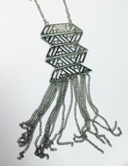Metal cutout aztec style fringe pendant necklace.
