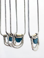 Hinged multi chain pendant necklace with geometric stones