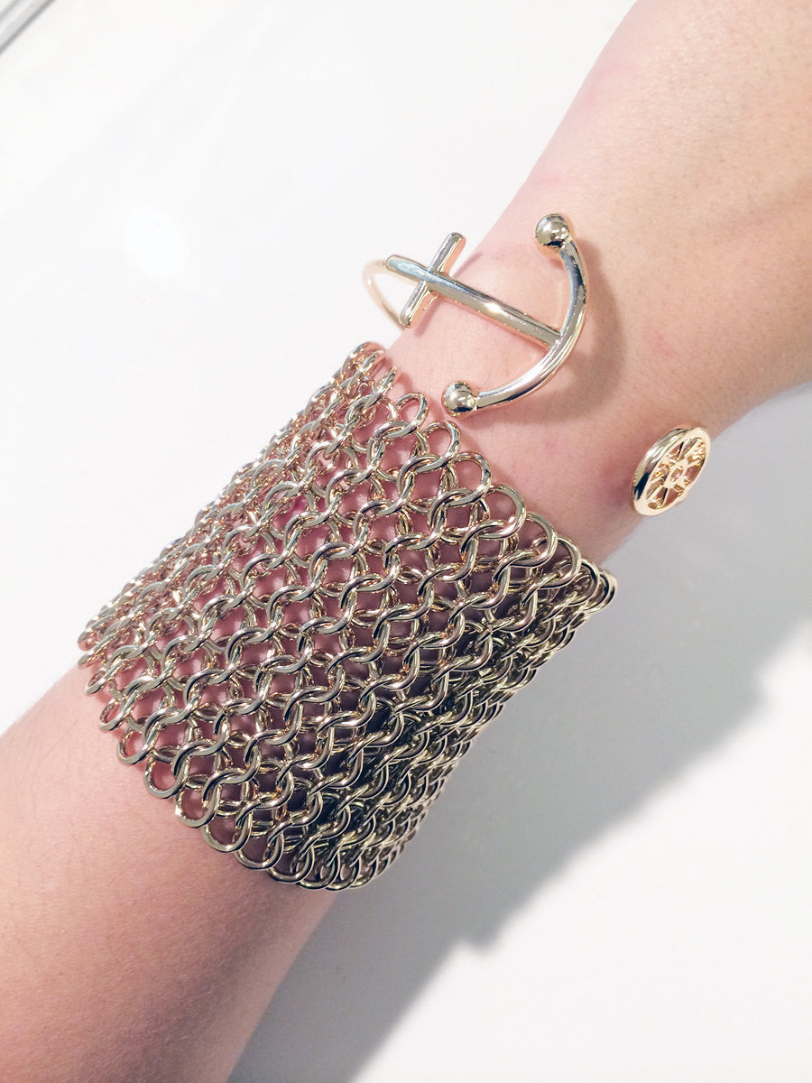 Gold chain mail bracelet with clip closure