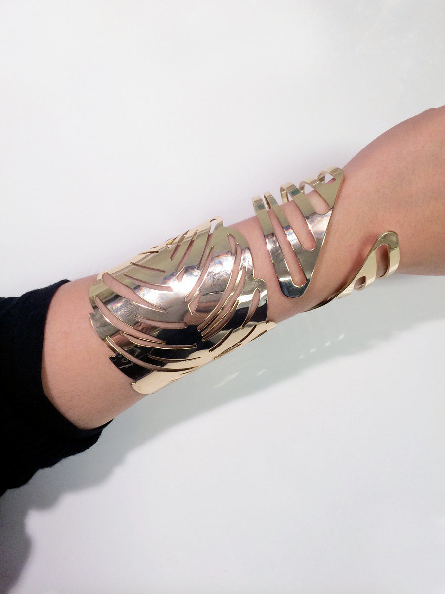 Laser cut feather gold bracelet consolidated