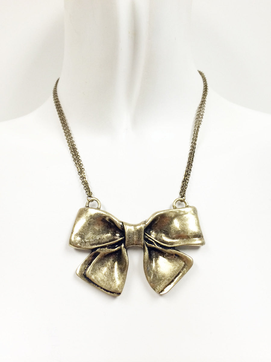 Oxidized gold bow pendant multi chain necklace, perfect for the Holidays!