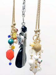 Multi charm stone gold plated necklace with chain wrapped ball