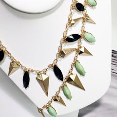 Green and black resin marquise boat stone charm necklace with antique gold pyramid charms