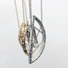 Half crescent intertwined chain necklace. Simply Unique. Gold and silver chains and metal.