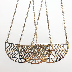 Crescent pendant necklace with geometric cutout design