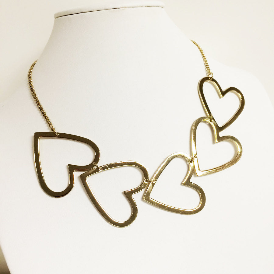Side heart 2-d cutout charm necklace with gold adjustable chain