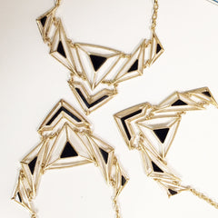 howlite bib necklace Only 2 left in turquoise . Geometric turquoise bib necklace with gold chains