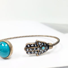howlite braceletOpen c shape bangle with hand charm with rhinestones and turquoise stone