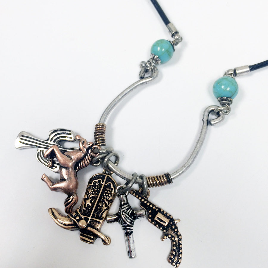 Bold horseshoe pendant necklace with western theme charms, horse charm, cactus charm, boot charm, and turquoise bead