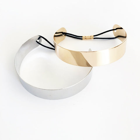 Upper arm cuff simple gold plated band with elastic for adjustability.