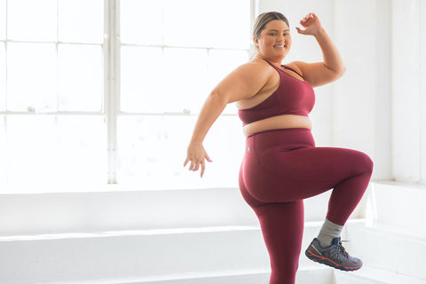 Carly Compton stretching in JOLYN activewear