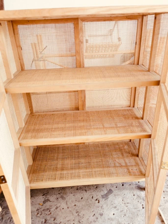 The Oakley Teakwood Webbing Rattan Cabinet Late July/August Delivery