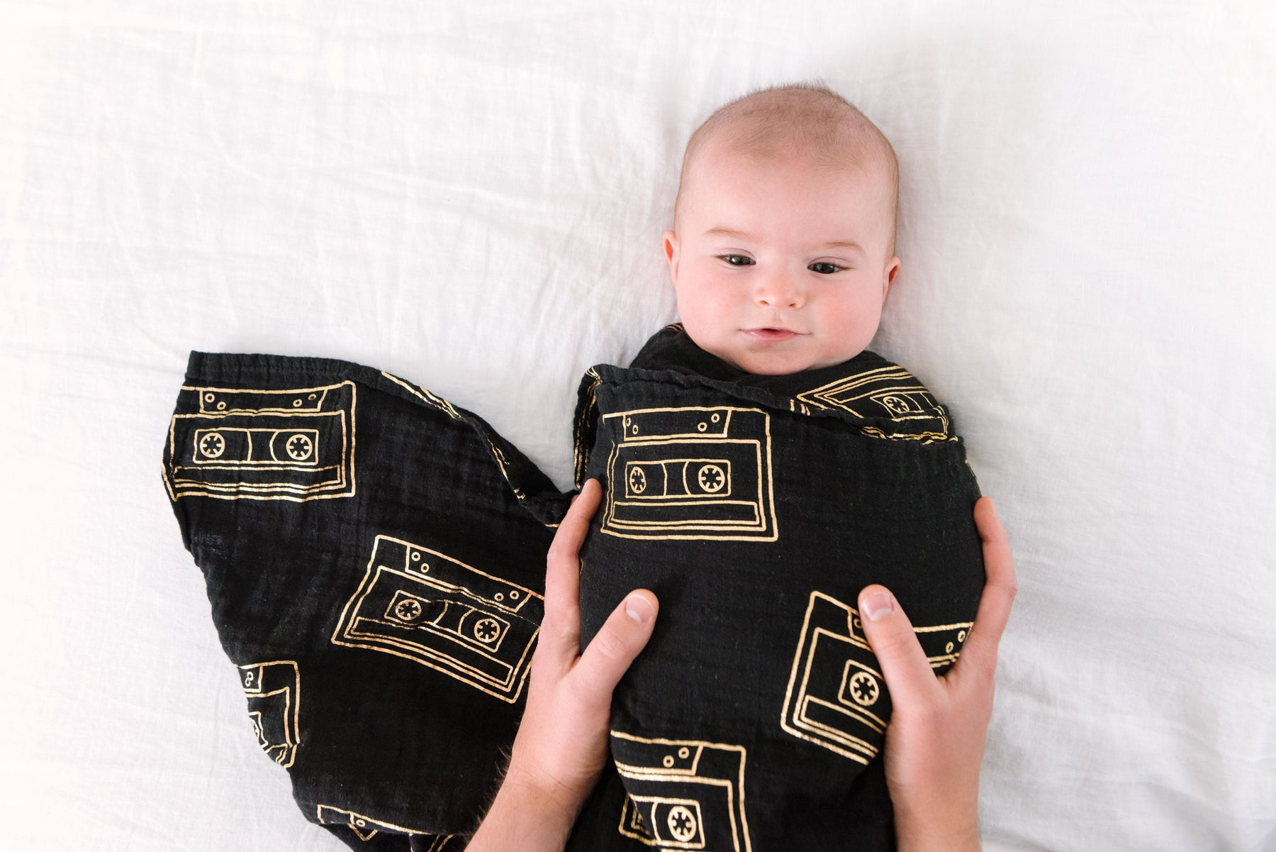 Black music swaddle blanket with cassette tapes