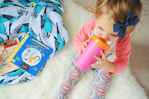Oliver + Kit Blue Parakeet Budgies Muslin Swaddle Blanket from the Birds of a Feather Duo is perfect in a sweet little girl's room