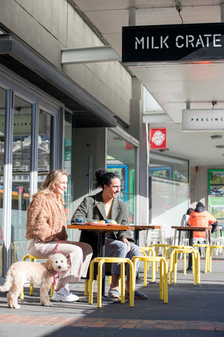 People outside cafe with dog