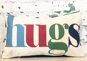 hugs pillow | primary multi
