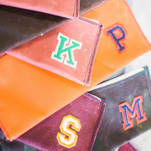 mitchell pouch | orange w/ varsity letter