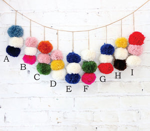 three stacked pom-poms