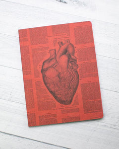 Red notebook with anatomical heart image and descriptions of the heart.