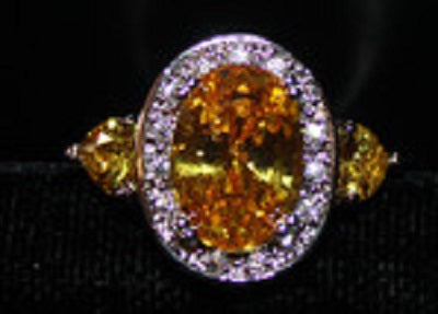 Faux Citrine Lg Stone with Surrounded by Clear Accent Stones Silvertone Ring Size 8 W00322