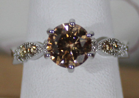 W00321 Silvertone Ring With Citrine Colored Center Stone and small stones on band Size 8