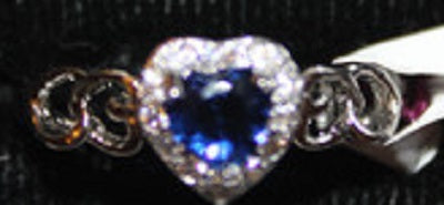 W00309 Silvertone Ring with Heart Shaped Dk Blue Stone with Accent Clear Faux Crystals Size 8