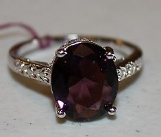W00318 Silvertone Purple Lg Stone with designs on band Size 8