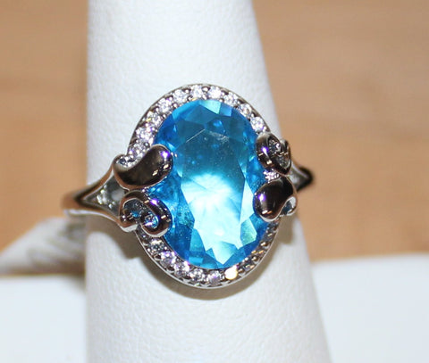 Elegant Silvertone Ring with Large Oval Faux Light Blue Crystal Size 9