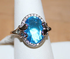 Elegant Silvertone Ring with Large Oval Faux Light Blue Crystal Size 7