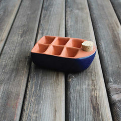 Ceramic seed starter in dark blue