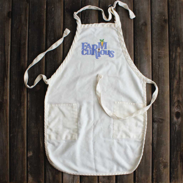 Sturdy cotton apron with FARMcurious logo