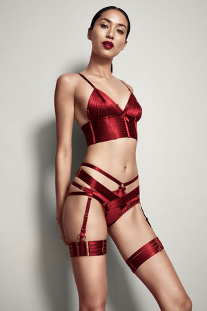 Bordelle Bondage harness brief in red with Bondage webbed garters