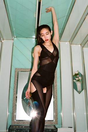 Julie Roche in DSTM Axon tights and Jung body. Shot by Maxime Ballesteros in a Tokyo love hotel for Tissue Magazine