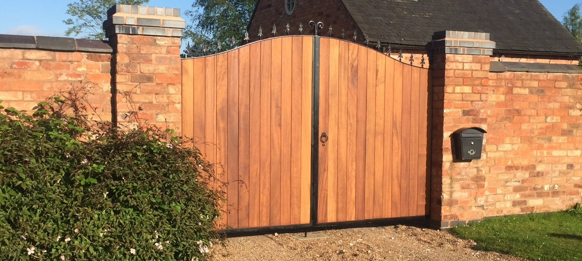 Timber Infill Gates - Metal Framed Gates. Handcrafted by UK's largest bespoke gate manufacturer. Stylish and durable, see our full range of driveway gate designs.