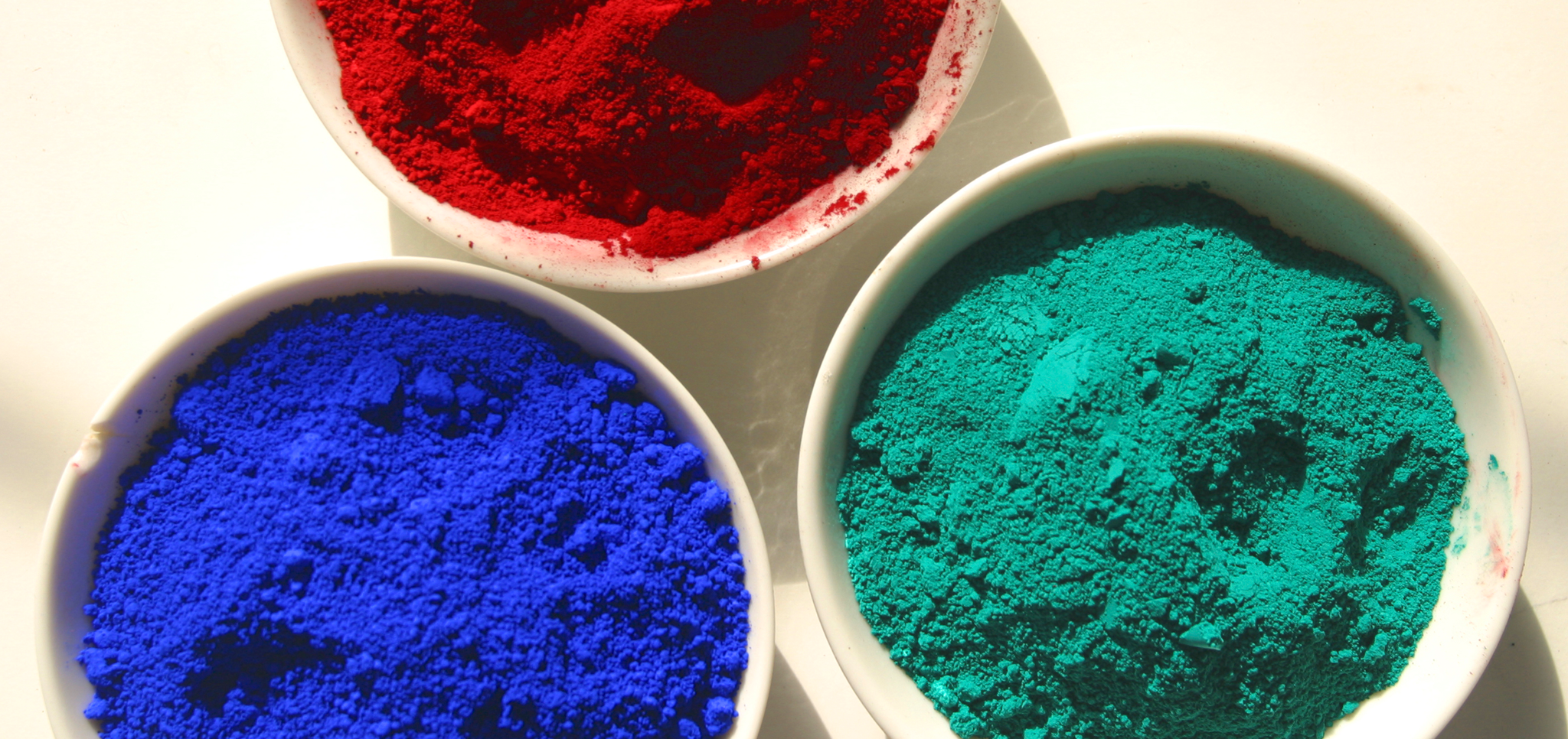 Picture of 3 ceramic containers of powdered ink pigment