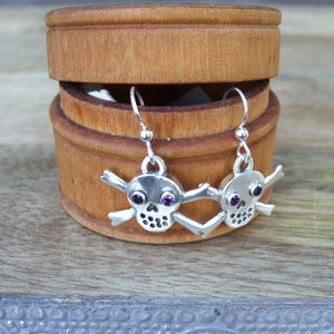 Sterling Silver Skull and Crossbone Drop Earrings set with Amethyst