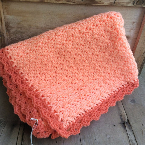 Crocheted blanket coral pink
