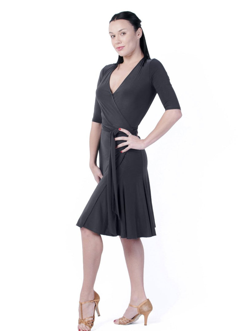 Miari Klaudia Wrap is a true wrap dress with an attached belt that loops through the dress and ties on the side.