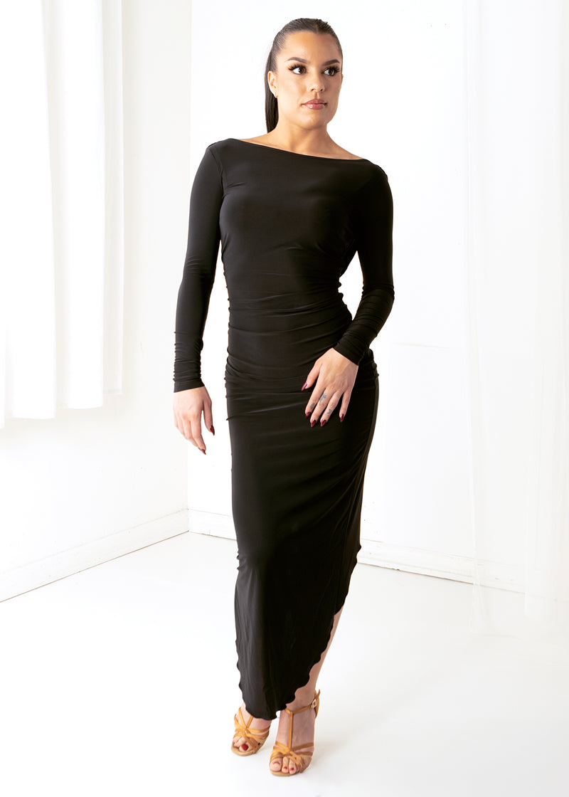 Long-sleeved black draped back ballroom dance dress with front waist gathered at the dancer's middle.