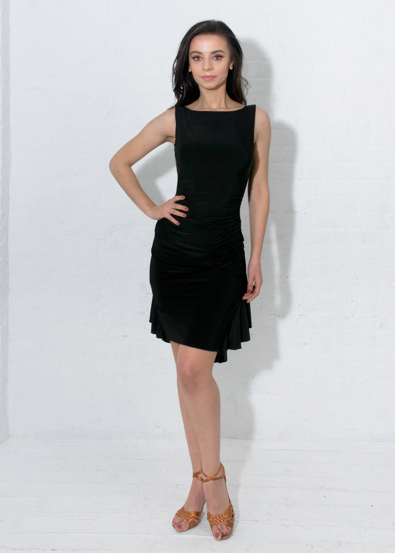 Boat neck neckline and side seam ruching gives this latin ballroom dance dress a super sleek silhouette. Includes shelf bra. Knee-length for most heights (5'3-5'5).